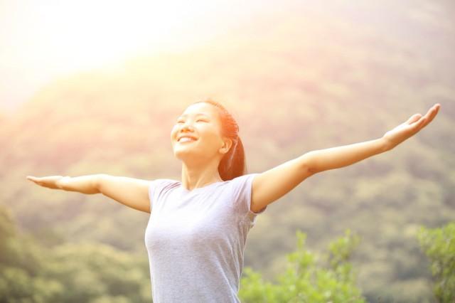 cheering-hiking-woman-open-arms-at-mountain-peak-000045952608_XXXLarge