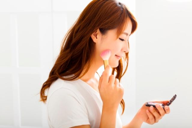 young beautiful woman with Makeup Brush