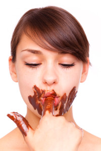 Woman-eating-chocolate-200x300