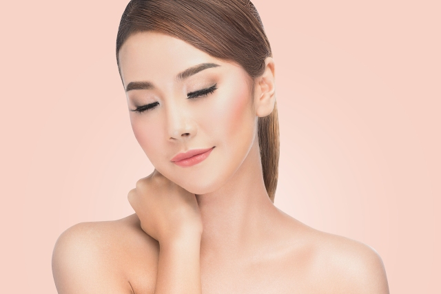 Beauty Asian portrait of beautiful cheerful young fresh woman. Youth and Skin Care. Beauty Model Female looking at camera.Concept. on pink background with clipping path.