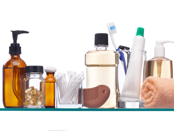 various personal hygiene products on glass shelfs